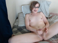 Relaxing on the bed so much inclines the horny Simone Belle to play with her cock fully naked.